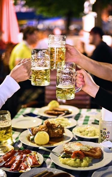 A toast to Schweinshaxe in the Viktualienmarkt biergarten