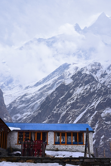 Snow-capped Machapucchare behind the base camp huts