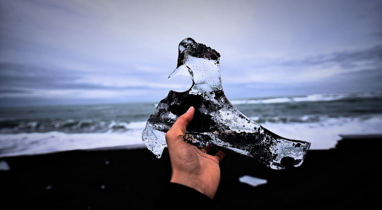 Holding Iceberg Diamond Beach Jokulsarlon Iceland DNXB dongnanxibei